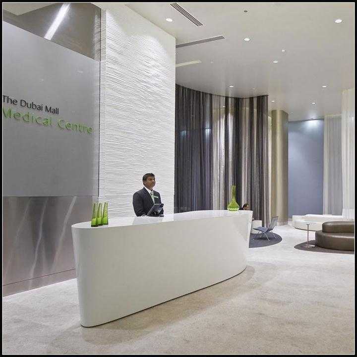 Modern mall center lobby small white solid surface standing reception desk