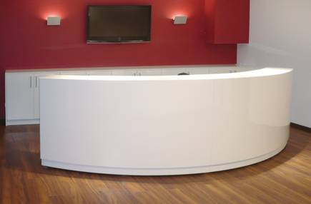 Curved office reception desk with file cabinet