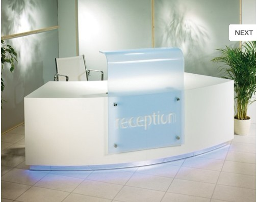 White office reception counter with logo