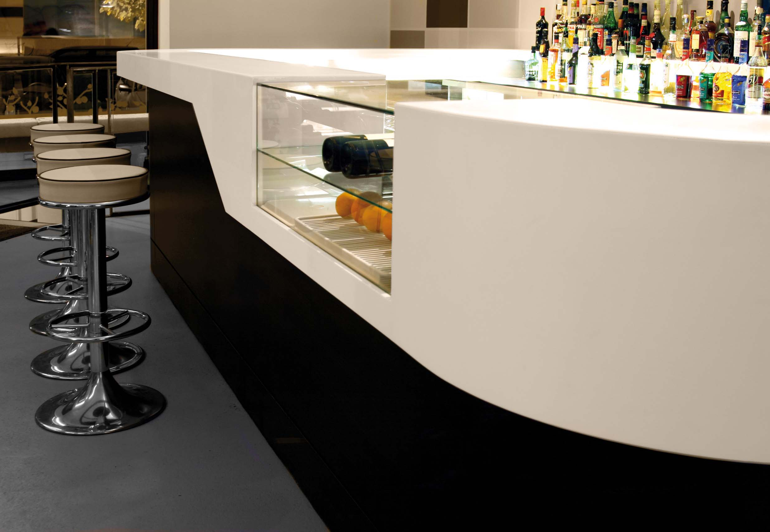 white and black artificial stone bar counter with refrigerator