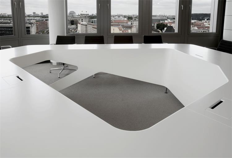 large many people marble board room table