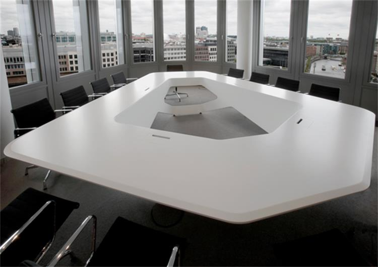 large many people solid surface meeting table
