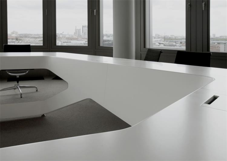 large many people white corian meeting table