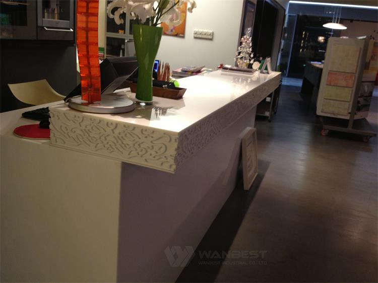 White carved reception desk