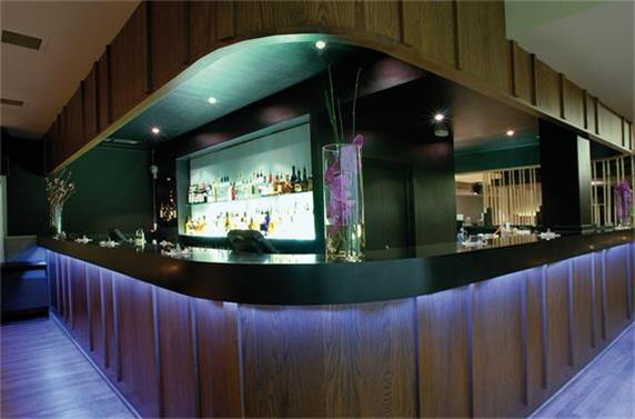 black solid surface table tops and wood material restaurant counter