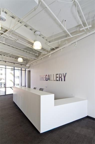 Big gallery white reception counter