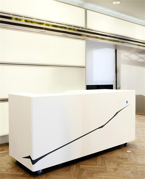 Simple white small reception desk