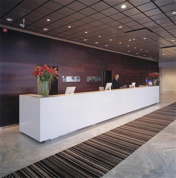 Long white clinic reception desk