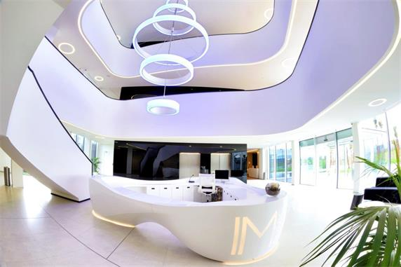 Circular white marble reception office design counter