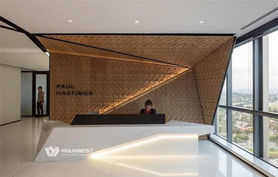 The white front desk receives special artificial stone with LED
