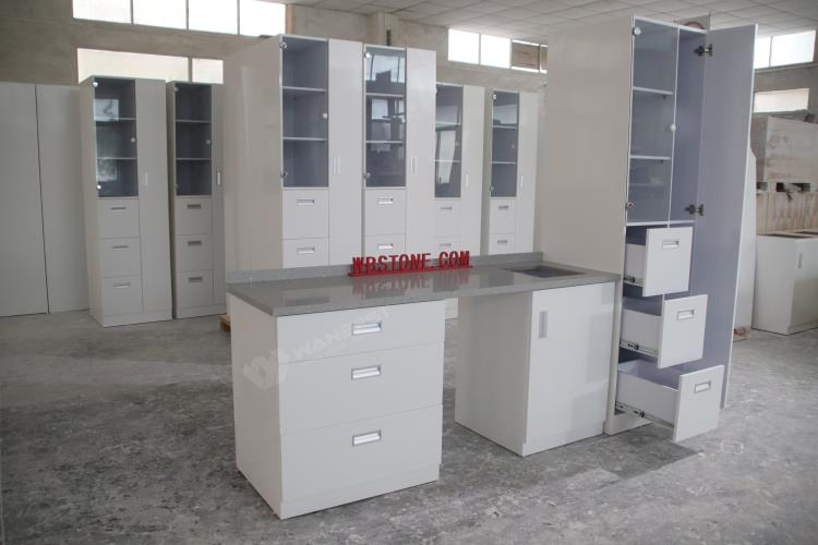 The cabinet of a set of corian kitchen counter
