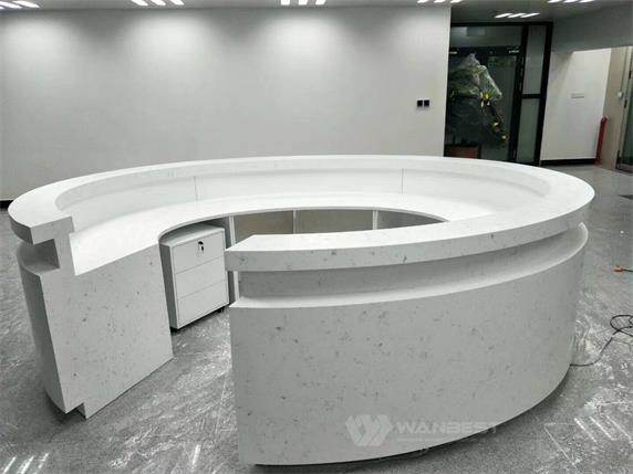 Round artificial stone large reception desk on the hall