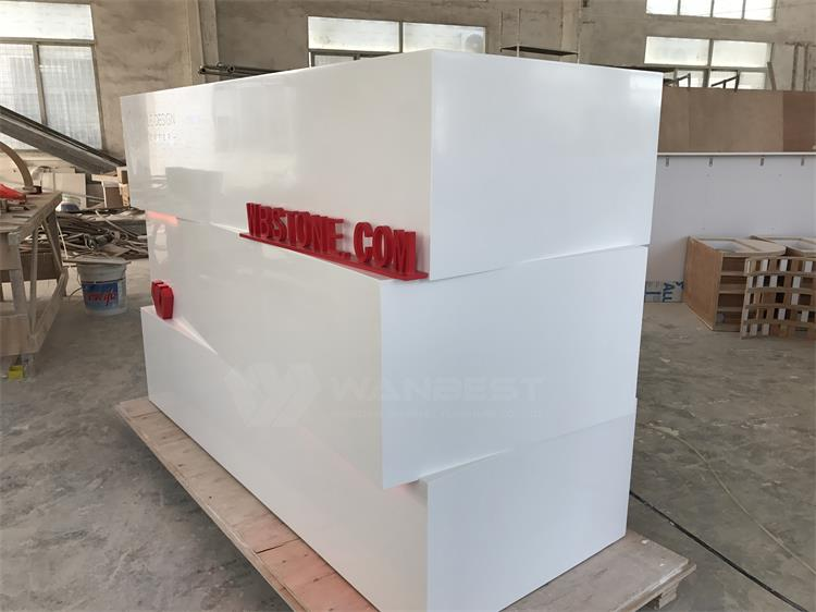 The side of  corian front counter
