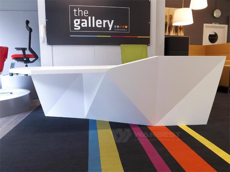 white solid surface reception desk