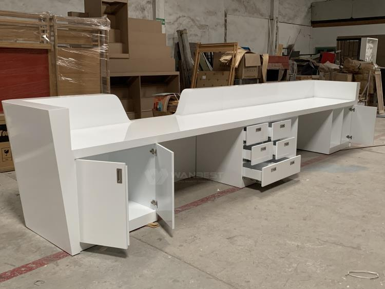 Large reception desk with many cabinets