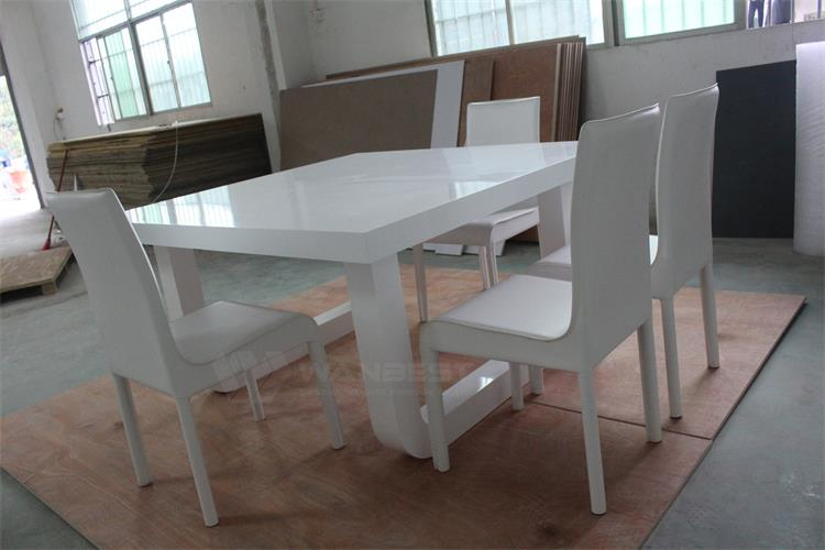 Modern white dining table with chairs