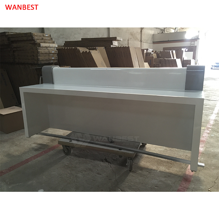 The behind of white & gray  reception desk
