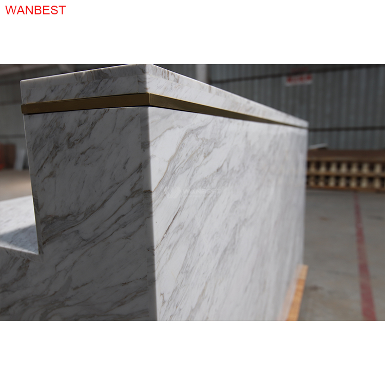 marble stone reception with gold stainless steel