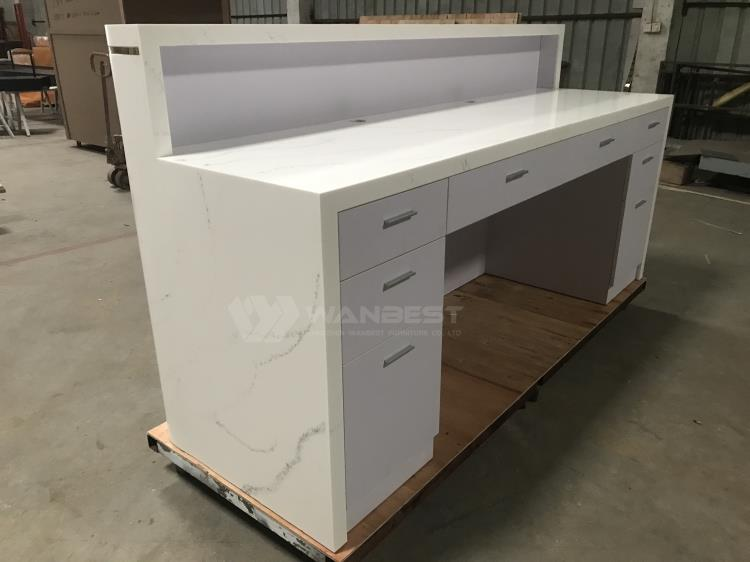 white reception desk with drawers